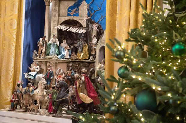 A Nativity scene and Christmas trees are seen during a preview of holiday decorations in the East Room of the White House in Washington, DC, November 27, 2017. / AFP PHOTO / SAUL LOEB        (Photo credit should read SAUL LOEB/AFP/Getty Images)