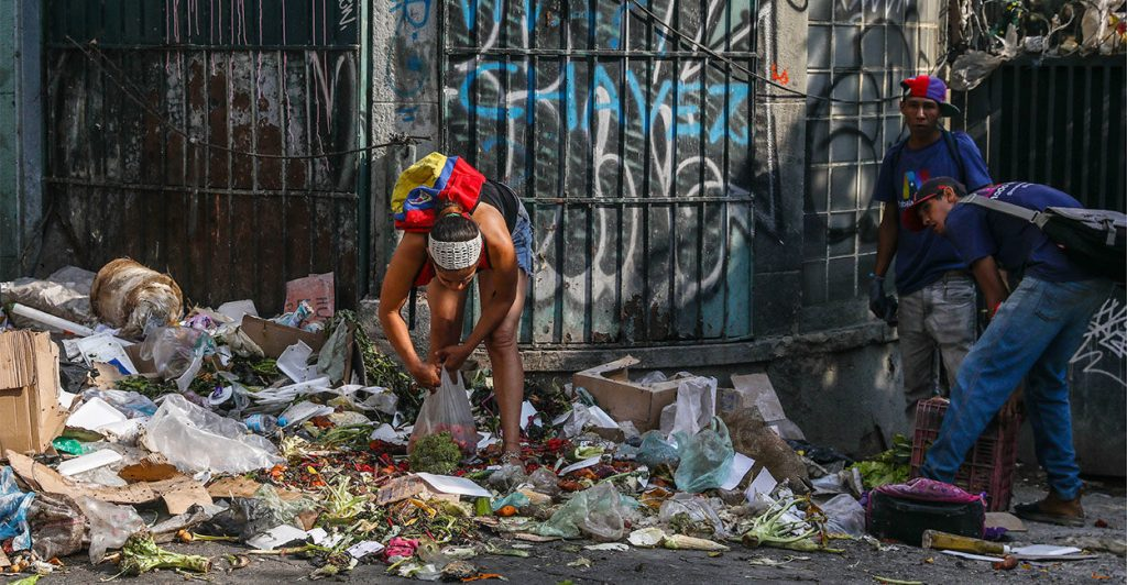 CARACAS, VENEZUELA - MARCH 5, 2019: Local residents looking for food in a pile of trash. Valery Sharifulin/TASS (Photo by Valery SharifulinTASS via Getty Images)